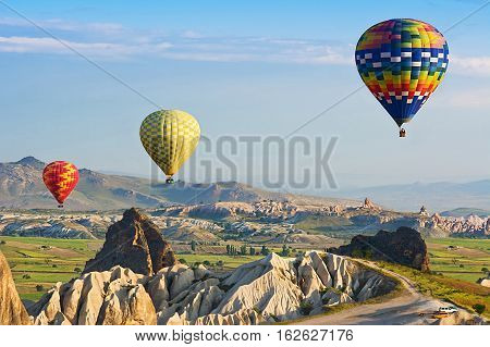 GOREME/ TURKEY - MAY 25, 2015: Hot air balloons take off in Cappadocia on may 25, 2015 in Goreme, Anatolia, Turkey. The great tourist attraction of Cappadocia - balloon flight.