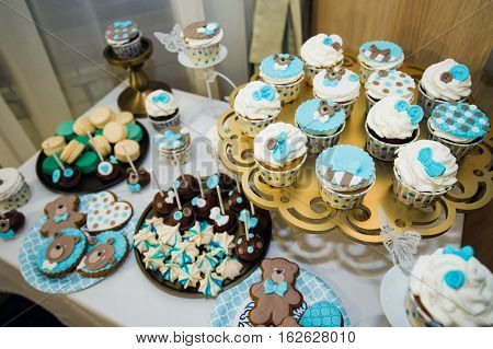 Delicious sweet buffet with cupcakes. Sweet holiday buffet with cupcakes and other desserts. Candy Bar. poster