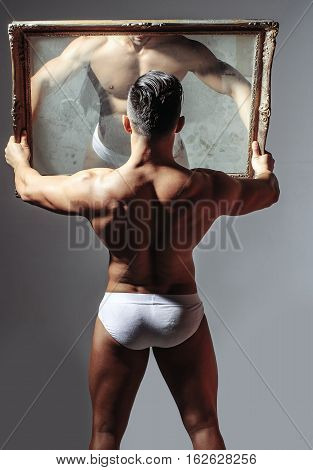 Handsome Muscular Bodybuilder At Mirror
