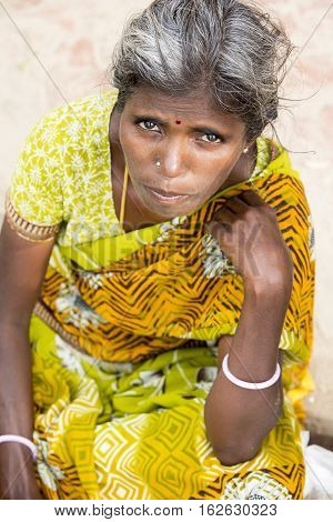 Illustrative image. Pondicherry Tamil Nadu India - April 14 2014. Portrait of senior indian woman in traditional costume. Poor women sad smiling sitting
