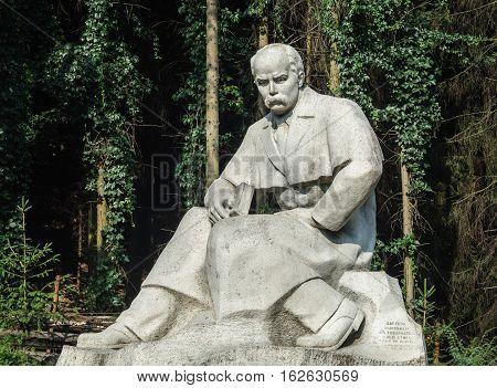 Lviv Ukraine - September 09 2016: Monument to Ukrainian poet Taras Shevchenko on forest background near the Museum of Folk Architecture