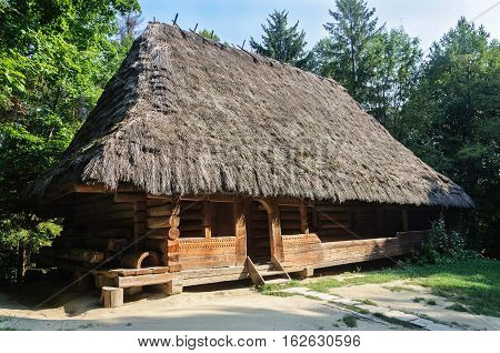 Lviv Ukraine - September 09 2016: Ancient Ukrainian authentic wooden house with thatched roof from Boyko's region Ukraine. Now in Museum of Folk Architecture in Lviv