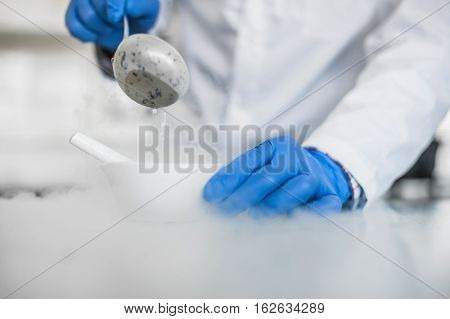 Laboratory Technician Performs An Experiment With Liquid Nitrogen