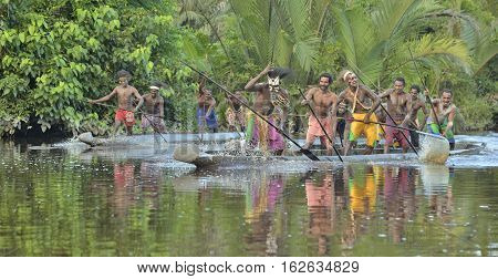 INDONESIA IRIAN JAYA ASMAT PROVINCE JOW VILLAGE - JUNE 23: Canoe war ceremony of Asmat people. Headhunters of a tribe of Asmat . New Guinea Island Indonesia. June 23 2016