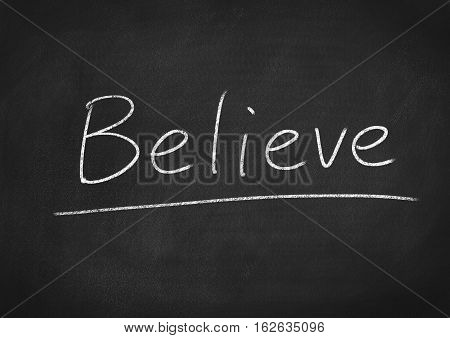 believe concept word text on blackboard background
