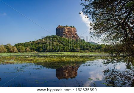 Sigiriya rock Fortress reflrct on sigiriya tank, Sri Lanka