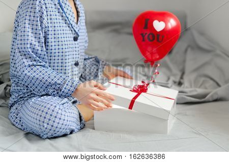 Woman In Pajamas Opens The Gift. Valentine's Day.