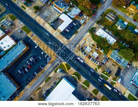 Cross Intersection black asphalt and dotted lines landscape urban sprawl transportation from high above the street level Austin Texas USA