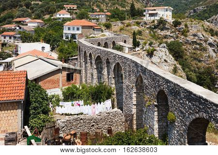 Ancient roman aqueduct cityscape view in Montenegro