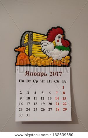 Tear-off calendar, a symbol of the new year rooster, white background