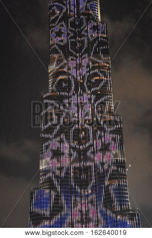 DUBAI, UAE - DEC 9: The LED lights show at Burj Khalifa in Dubai, UAE, as seen on Dec 9, 2016. The show titled Ascension, by London-based Yusuke Murakami and Tangent Design and Invention illuminated and animated the Burj Khalifa during Dubai Design Week.