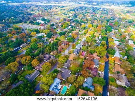 Aerial bird's Eye View high above Texas Hill Country.  Texas expands more and more homes are built in Modern Neighborhood Communities