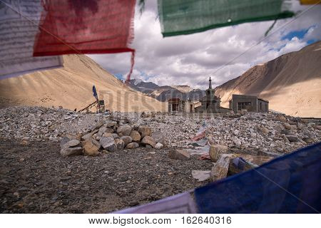 Colorful prayer flags with motion at Pangong Lake, Ladakh, India.