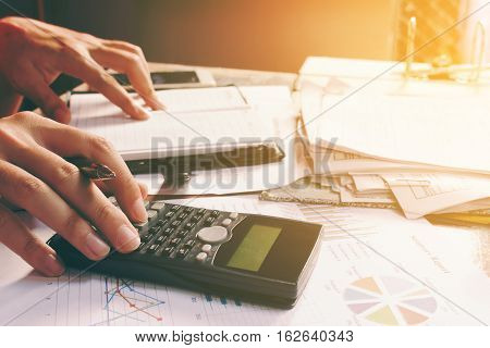 Asian Young Man Calculating About Cost And Expenses Home Office.