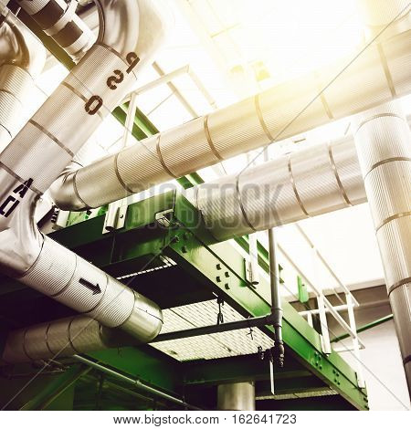 Industrial power generation plant factory with high preasure steam pipes and valves. Green energy power generation plant.