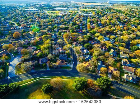 Thousands of Homes along Country side Hill Country outside of Austin Texas USA aerial drone shot over Community Neighborhood