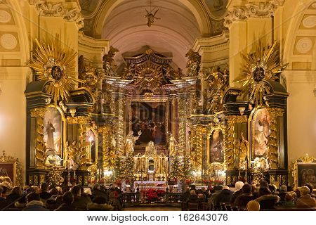 POLAND KRAKOW - JANUARY 01 2015: Inside of the catholic monastery Church of Sts. Bernardine of Siena with Christmas decorations. The interiors of the church made in baroque style.
