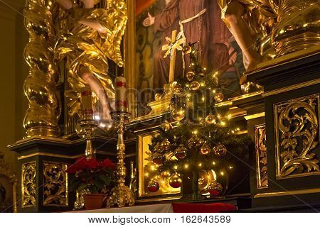 POLAND KRAKOW - JANUARY 01 2015: Altar of the catholic monastery Church of Sts. Bernardine of Siena with Christmas tree. The interiors of the church made in baroque style.