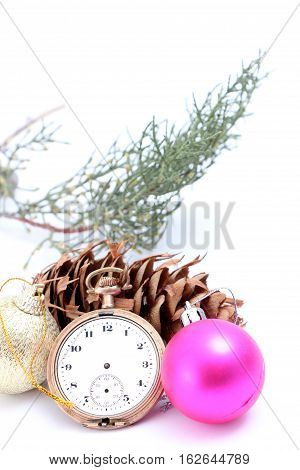 picture of a Christmastime with vintage clock baubles and cone