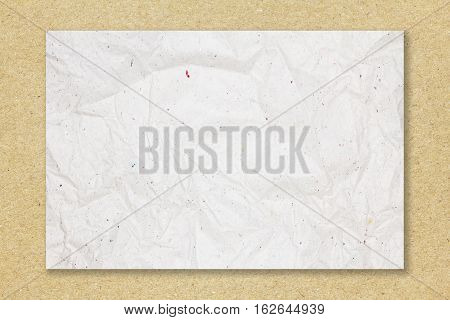 Recycled crumpled white paper on recycled crumpled brown paper background for design with copy space for text or image.