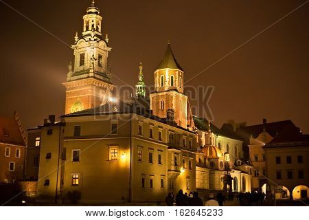 View of the Wawel Royal Archcathedral Basilica of Saints Stanislaus and Wenceslaus and Wawel castle on the Wawel Hill at winter night Krakow Poland.