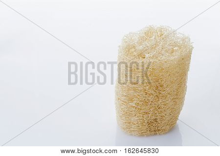 Luffa loofa natural vegetable fiber for body scrubbing and used in skin care on a white background.