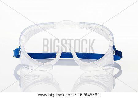 Clear Safety Glasses Against On White Background