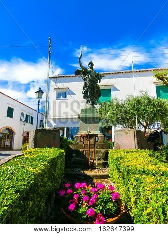 Capri, Italy - May 04, 2014: The sculpture on Piazza Umberto I, the most famous square of the island of Capri, Italy on May 04, 2014