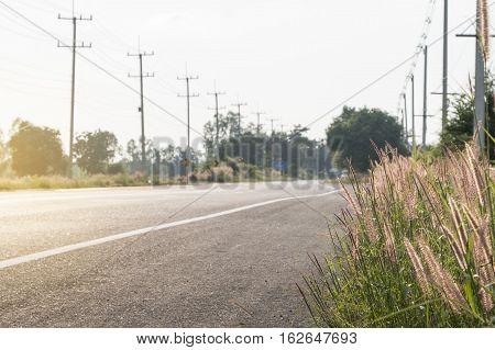 Empty asphalt road between field in the rural landscape.