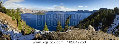 Crater Lake daytime panorama with snow. Oregon, USA