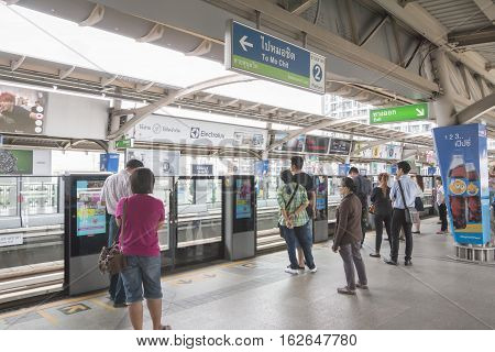 Bangkok Thailand - November 07 2015: People standing in lines waiting for BTS sky train at On Nut station.