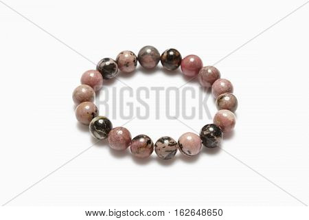 Lucky brown stone bracelet on white background.