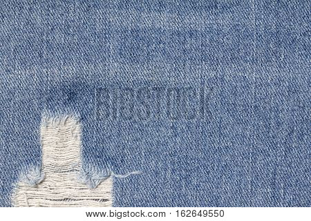 Denim jeans texture or denim jeans background with old torn. Old grunge vintage denim jeans. Stitched texture denim jeans background of jeans fashion design.