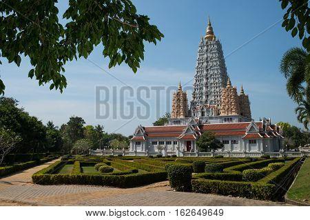 Wat Yan Sang Wararam Woramahawihan temple are the mondop where a replica of the Buddha's footprint is enshrineda large chedi containing Buddha relics. Pattaya, Thailand. poster