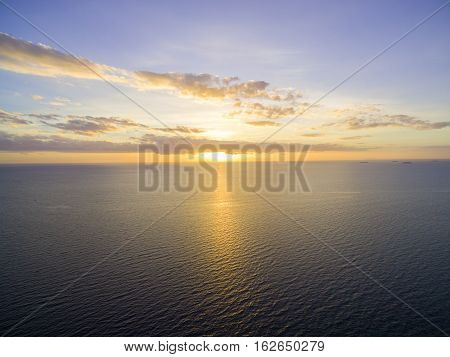 Beautiful glowing sunset over calm bay waters
