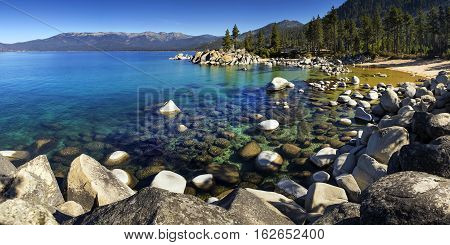 Sand Harbor Lake Tahoe Nevada on a sunny day with blue sky and clear water.
