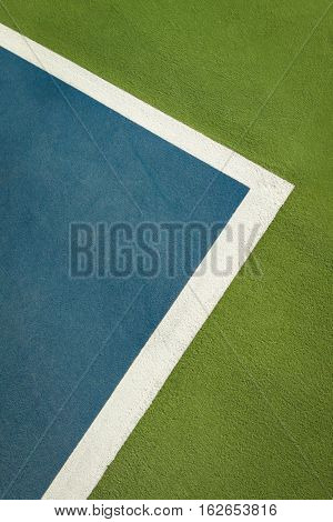 Background of Tennis court with lines and colored markings.