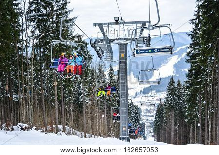 BUKOVEL, UKRAINE - December 17, 2016 : Skiers on a cable car in Bukovel. Bukovel is the most popular ski resort in Ukraine. Ski season and Winter sports concept