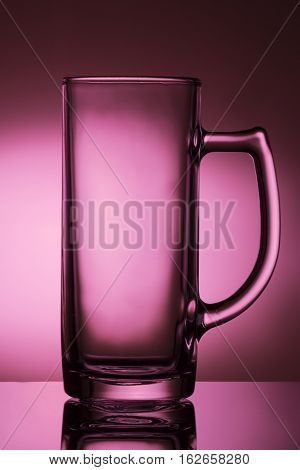 Glass for beer drink on a pink background. Glasswares