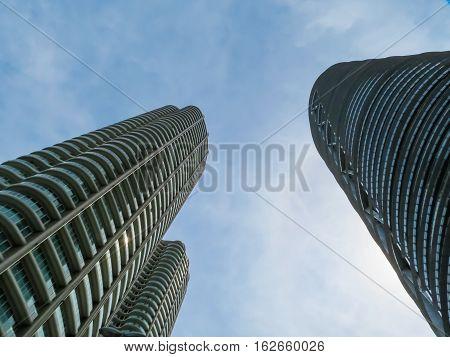 KUALA LUMPUR, MALAYSIA - JANUARY 12, 2014: Petronas Twin Towers and blue sky as background. Kuala Lumpur, Malaysia