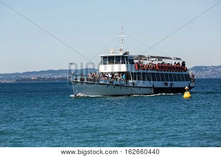 LAZISE ITALY - APRIL 30 2016: Ferry boat on Lake Garda. Garda Lake is one of the most frequented tourist regions of Italy.