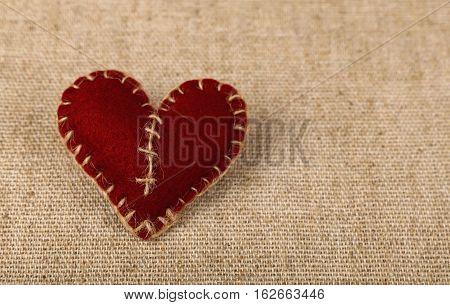 Brown Felt Craft Heart Over Canvas Close Up