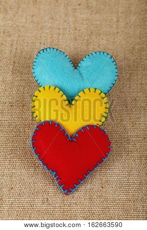 Three Felt Craft Hearts, Yellow, Red And Blue