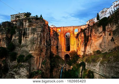 Ronda Spain. Illuminated New Bridge over Guadalevin River in Ronda Andalusia Spain. Popular landmark in the evening