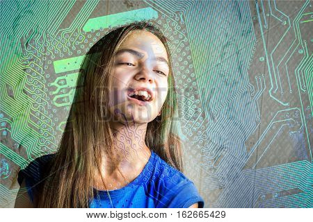 Portrait of a 11 year old girl with her mouth open through a circuit board silhouette. Concept of new generation computer science and informatics lessons cyber society.