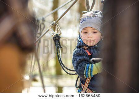 Kiev, Ukraine - March 30, 2016: A Kid Crossing  Rope Bridge At