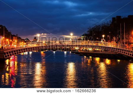 Dublin Ireland. Night view of famous Ha Penny bridge in Dublin Ireland