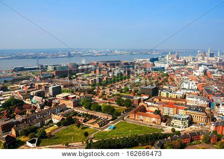 Liverpool UK. Aerial view of Liverpool UK residential area and downtown with river during the sunny day