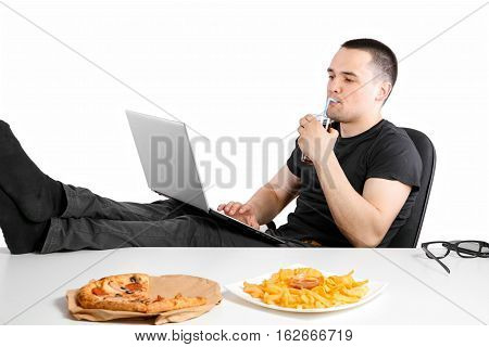 Man Working At The Computer And Eating Fast Food. Unhealthy Lifestyle.