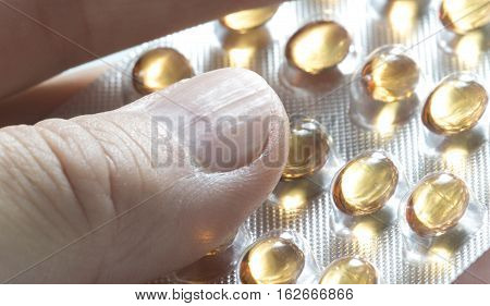 Patient ready to take vitamin D tablet